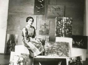 Soshana with painting wearing a Sari   Paris 1957